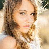 picture of tallgrass  - Portrait of young beautiful model in open field at sunrise  - JPG