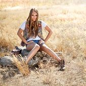 image of tallgrass  - Hippie looking girl sitting on a tree stump  - JPG