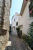 foto of stone house  - Historical stone houses and narrow street under bright sunny sky - JPG