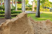 stock photo of sand gravel  - Pile of sand in public outdoor park - JPG