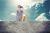 foto of half-dressed  - Businessman looking on a ladder against brick lined wall covering half sky - JPG