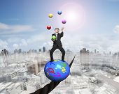 picture of juggler  - Juggling businessman standing on top of colorful symbols ball balancing on a wire with sun mist cityscape background - JPG