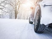 image of slippery-roads  - car tires on witer road in snowy morning - JPG