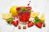 picture of cold drink  - Cold strawberry drink with fresh strawberries and lemon on white wooden background - JPG