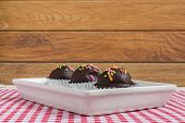 foto of cake-ball  - Fresh chocolate ball cakes sprinkled with colorful sugar balls - JPG