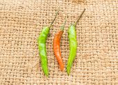 picture of sackcloth  - Red and green chili pepper on a sackcloth background - JPG