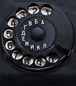 picture of rotary dial telephone  - rotary dial of old dirty broken phone  - JPG