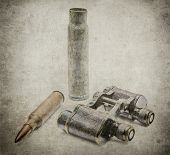 picture of bullet  - Japanese military binoculars since the First World War with bullets in grunge - JPG