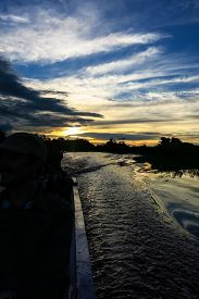pic of pampa  - sunset inside a motorboat - JPG