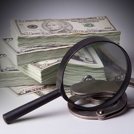 foto of punish  - Finance and Law economic crime the punishment of the offender pack of dollars steel handcuffs square image DSLR photography finance and law shadow capital punishment crime. ** Note: Shallow depth of field - JPG