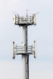 stock photo of telecommunications equipment  - telecommunication equipment on top of antenna tower - JPG
