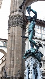 foto of beheaded  - Perseus bronze sculpture by Benvenuto Cellini Piazza della Signoria Florence. Italy ** Note: Soft Focus at 100%, best at smaller sizes - JPG
