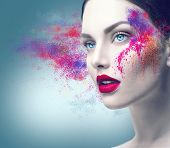 Fashion model girl portrait with colorful powder make up. Beauty woman bright color makeup. Close-up poster