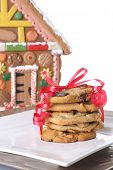 stock photo of gingerbread house  - Christmas cookies in front of a gingerbread house cookie jar - JPG