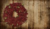 stock photo of red siding  - A country Christmas wreath - JPG
