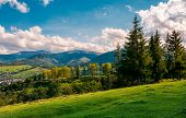 Beautiful View In To The Rural Valley. Gorgeous Countryside With Forest On Grassy Hill And Distant M poster