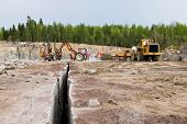 stock photo of oversize load  - Excavation and dump vehicle in a granite quarry - JPG