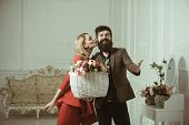 Love Concept. Couple In Love With Basket Of Flowers. Sensual Woman Kiss Bearded Man With Love. Love  poster