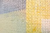Yellow And Gray Stone Bricks Wall Texture. Urban Paintetd Bricks As Exterior Background poster