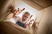 The Surprised Senior Man Unpacking, Opening Carton Box And Looking Inside. The Package, Delivery, Su poster