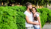 Couple In Love Romantic Date Walk Nature Park Background. Man Bearded Hipster Hugs Gorgeous Girlfrie poster