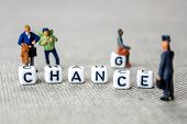 Changing White Cubes With Word change To chance On Grey Background With Miniature Figurines poster