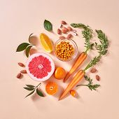 Healthy vegetarian food - orange organic vegetables and fruits on a paper background. Top view. Conc poster