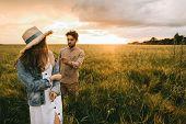 View Of Elegant Couple Walking On Meadow Tenderness poster