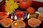 Beautiful diwlai thali with lit diya