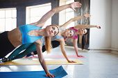 Leisure, Sport, Fitness, Yoga Class, Relaxation, Balance, Flexibility. Fit Women Practicing Yoga In  poster