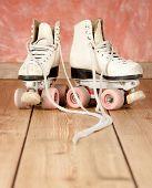 roller skates on a wood background
