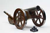 foto of cannon-ball  - Model muzzle loader cannon with lead balls - JPG