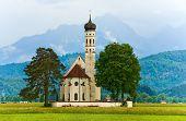 Neuschwanstein Castle In Germany And Church Near
