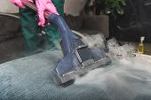 Cropped Shot Of Person Cleaning Sofa With Vacuum Cleaner, Hot Steam Cleaning Concept poster