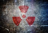 stock photo of reactor  - abstract radioactive symbol on a grunge wall - JPG