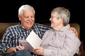Happy Senior Couple With Greeting Card