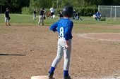 Little League Player On 3Rd Base Wiping Hands On Pants.