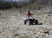 Atving Through A Riverbed