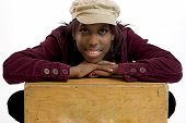 foto of eye brow ring  - Hip young black woman leaning on a box with room for copy space - JPG