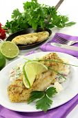 stock photo of hake  - Potato salad with fresh herbs and hake fillet - JPG