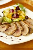 Duck breast with fruit flambe and berry sauce