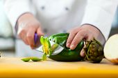 stock photo of chef knife  - Chef chopping vegetables - JPG