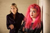 image of cynicism  - Indifferent European mother with daughter in pink hair - JPG
