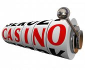 The word Casino on slot machine wheels to symbolize a fun gambling destination such as Las Vegas or