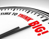 The words Time to Think Big on a Clock to illustrate the need to support innovation and creativity t