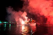 PELOPONNESE, GREECE- MAY 29: The ritual burning of Judas Iscariot at sea during the Orthodox Easter,