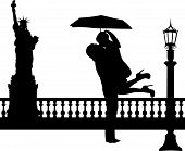 Couple in love with umbrella in New York silhouette