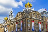 AMSTERDAM, NETHERLANDS - APRIL 30: decorated buildings on occasion from the coronation of the new king Willem Alexander from the Netherlands on 30 april 2013