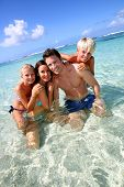 image of west indies  - Couple and children in crystal clear water - JPG