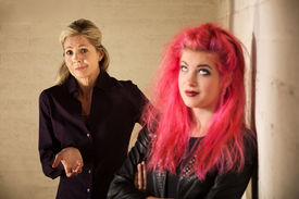 image of sarcastic  - Indifferent European mother with daughter in pink hair - JPG